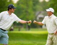 Nathan Smith, left, fist bumps his partner Todd White, right, on the eighth hole during first round of stroke play of the 2016 U.S. Amateur Four-Ball at Winged Foot Golf Club in Mamaroneck, N.Y. on Saturday, May 21, 2016.  (Copyright USGA/Fred Vuich)